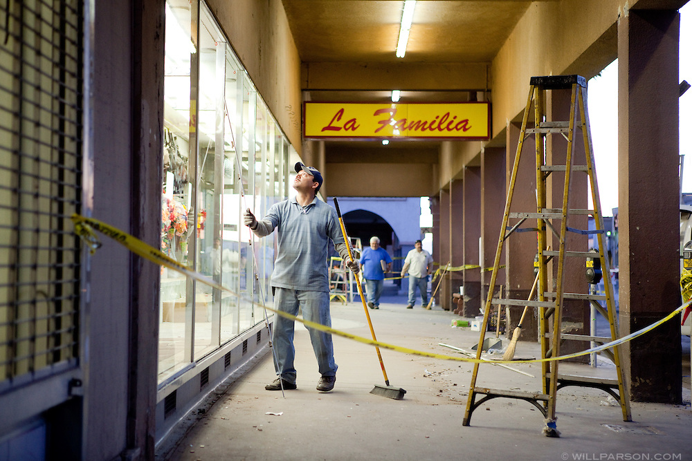 Workers clean and repair a storefront in downtown Calexico. A group of researchers led by Dr. Benson Shing, Vice Chair of the Department of Structural Engineering at the University of California, San Diego, inspected the earthquake damage in Mexicali, Mexico and Calexico, CA, April 7, 2010. A 7.2 magnitude earthquake in Baja California on Easter Sunday was felt as far away as Los Angeles.