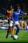 Match winner Demarai Gray on the attack during the Sky Bet Championship match between Birmingham City and Wolverhampton Wanderers at St Andrews, Birmingham, England on 11 April 2015. Photo by Alan Franklin.