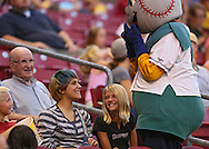 Trenton Strom (from left) 10, Alivia Severson, 13, and Hope Strom, 11, all of Cedar Rapids enjoy a laugh with Mr. Shucks during the game between the Beloit Snappers and the Cedar Rapids Kernels at Veterans Memorial Stadium in Cedar Rapids on Saturday evening, August 25, 2012.