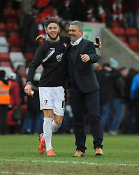 Cheltenham Town's Wes Burns is applauded by Cheltenham Town Manager, Russell Milton after the final whistle. - Photo mandatory by-line: Nizaam Jones - Mobile: 07966 386802 - 28/02/2015 - SPORT - Football - Cheltenham- Whaddon Road - Cheltenham Town v Tranmere Rovers - Sky Bet League Two