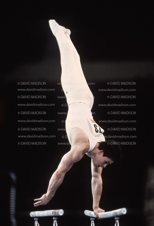 PHOENIX - APRIL 24:  Dimitri Belozerchev of the USSR competes on the parallel bars during a USA - USSR gymnastics meet on April 24, 1988  at the Arizona Veterans Memorial Coliseum in Phoenix, Arizona.  (Photo by David Madison/Getty Images)