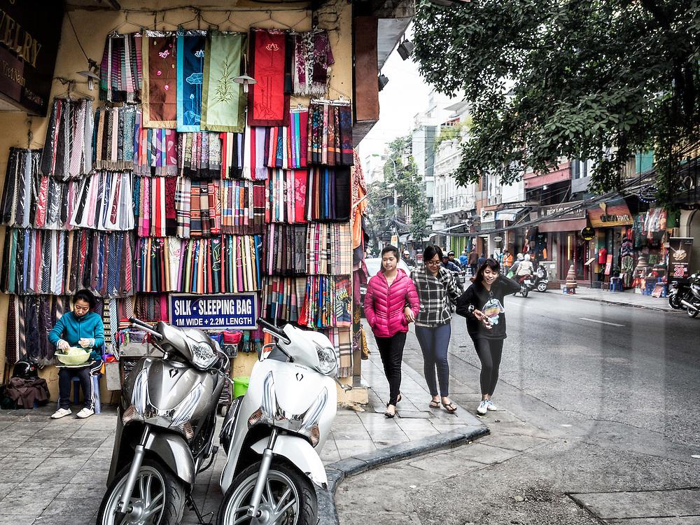 Silk garments hang on the facade of a shop along Hang Gai 'silk street' in Hanoi's Old Quarter, Vietnam, Southeast Asia