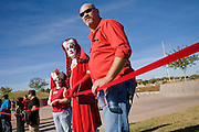 01 DECEMBER 2008 -- PHOENIX, AZ: AIDS activists in Phoenix hold a portion of the AIDS ribbon they created in a Phoenix park Monday. AIDS activists in Phoenix made the world's largest AIDS Ribbon to mark World AIDS Day, Dec. 1. According to Guinness  World Records, the previous largest AIDS ribbon measured 43 feet long. The ribbon created the Phoenix activists was more than 330 feet long. They plan to submit their ribbon to the Guinness Book of World Records.  Photo by Jack Kurtz / ZUMA Pres