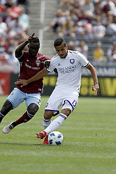 April 29, 2018 - Commerce City, Colorado - Orlando City SC defender Mohamed El-Monir (13) battles for the ball with Colorado Rapids midfielder Bismark Adjei-Boateng (21) in the first half of action in the MLS soccer game between Orlando City SC and the Colorado Rapids at Dick's Sporting Goods Park in Commerce City, Colorado (Credit Image: © Carl Auer via ZUMA Wire)