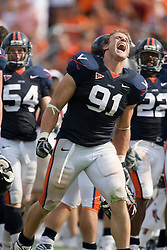 Virginia defensive end Chris Long (91) celebrates on the sideline after a sack.  The Virginia Cavaliers football team faced the Georgia Tech Yellow Jackets at Scott Stadium in Charlottesville, VA on September 22, 2007.