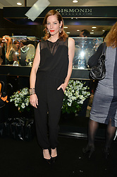 SIENNA GUILLORY at the opening of the new Gismondi Jewellery boutique, 14 Albermarle Street, London on 9th October 2014.