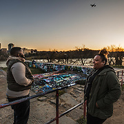 WASHINGTON, DC - MAR23: Stephon Cummings and Chelsea Jackson, from Silver Spring, MD, enjoy the sunset at the aqueduct on the Chesapeake and Ohio (C&O) Canal in Georgetown, March 23, 2017. Georgetown Heritage the National Park Service, and the DC Office of Planning are planning to upgrade the one mile stretch of the C&O Canal that runs through Georgetown to create a destination experience like the Highline in New York City. (Photo by Evelyn Hockstein/For The Washington Post)