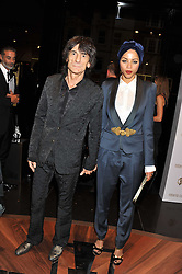 RONNIE WOOD and ANA ARAUJO at a party hosted by Roberto Cavalli to celebrate his new Boutique's opening at 22 Sloane Street, London followed by a party at Battersea Power Station, London SW8 on 17th September 2011.