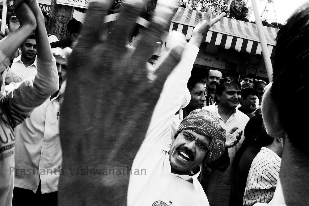 Supporters of social activist Anna Hazare shout slogans against corruption in New Delhi, India, on Friday, April 8, 2011. Hazare has vowed to fast to the death to rid India of the corruption he says is its biggest curse. Photographer: Prashanth Vishwanathan
