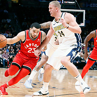 01 November 2017: Toronto Raptors guard Fred VanVleet (23) drives past Toronto Raptors forward Norman Powell (24) during the Denver Nuggets 129-111 victory over the Toronto Raptors, at the Pepsi Center, Denver, Colorado, USA.