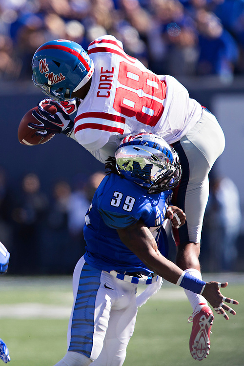 MEMPHIS, TN - OCTOBER 17:  Cody Core #88 of the Ole Miss Rebels catches a pass and is hit by Reggis Ball #39 of the Memphis Tigers at Liberty Bowl Memorial Stadium on October 17, 2015 in Memphis, Tennessee.  The Tigers defeated the Rebels 37-24.  (Photo by Wesley Hitt/Getty Images) *** Local Caption *** Cody Core; Reggis Ball