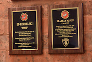 WARMINSTER, PA -  NOVEMBER 11: Some of the rededicated plaques are unveiled at the re-dedication of the Veteran's Wall of Honor November 11, 2013 at William Tennent High School in Warminster, Pennsylvania. (Photo by William Thomas Cain/Cain Images)