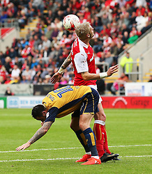 Greg Halford of Rotherham United heads clear under pressure from Lee Tomlin of Bristol City  - Mandatory by-line: Matt McNulty/JMP - 10/09/2016 - FOOTBALL - Aesseal New York Stadium - Rotherham, England - Rotherham United v Bristol City - Sky Bet Championship