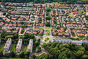 Nederland, Zuid-Holland, Den Haag, 15-07-2012; Sportlaan met flats uit de wederopbouw periode. Linksonder Ranonklestraat. Boven in beeld de Vogelwijk, Kwartellaan..Aan weerszijden van de Sportlaan de 'Atlantikwall strook'. In dit gebied is tijdens de Tweede Wereldoorlog de bevolking geëvacueerd en de bebouwing ontruimd en/of gesloopt ivm aanleg tankgracht. .On both sides of the Sportlaan the Atlantic Wall strip. During the Second World War, the population of this area was evacuated and some of the buildings were demolished in order to build a antitank ditch. Post-war reconstruction appartment buildings...QQQ.luchtfoto (toeslag), aerial photo (additional fee required).foto/photo Siebe Swart