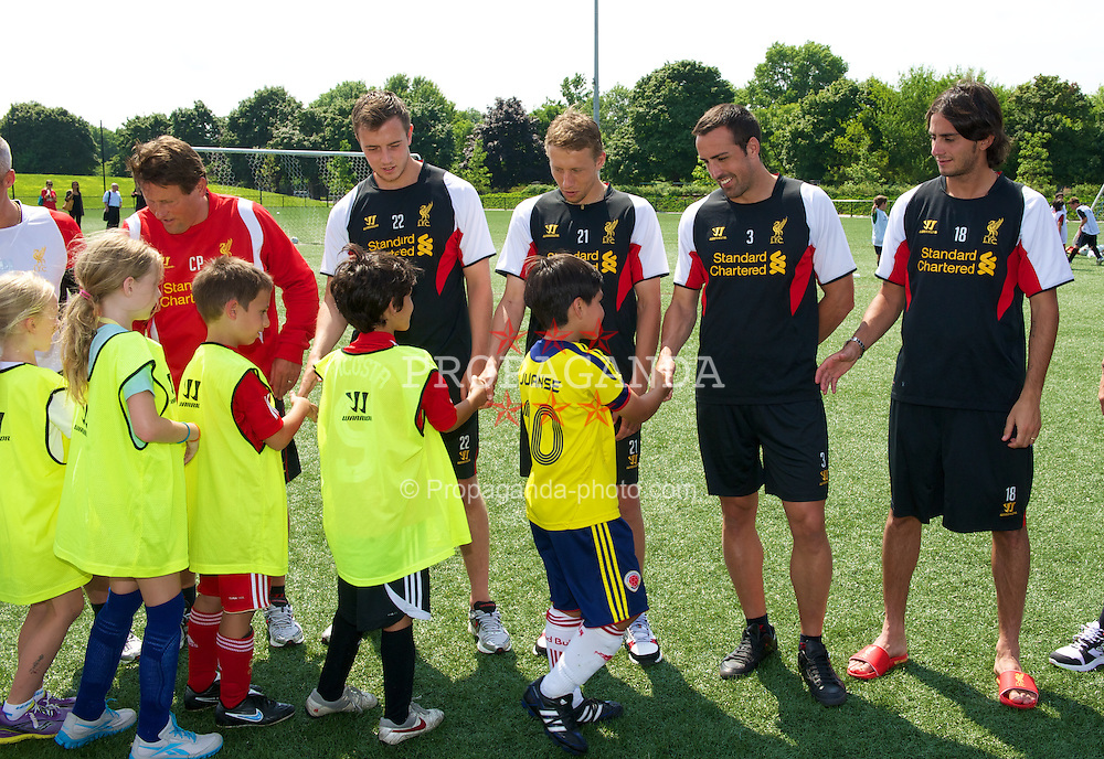 BOSTON, MA - Monday, July 23, 2012: Liverpool's Danny Wilson, Lucas Leiva, Jose Enrique and Alberto Aquilani during a LFC Foundation event at Harvard Stadium fields during the club's North American pre-season tour. (Pic by David Rawcliffe/Propaganda)