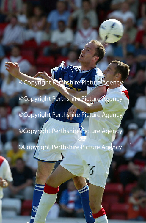Airdrie v St Johnstone...07.08.04<br />Michael Moore beats David Dunn<br /><br />Picture by Graeme Hart.<br />Copyright Perthshire Picture Agency<br />Tel: 01738 623350  Mobile: 07990 594431