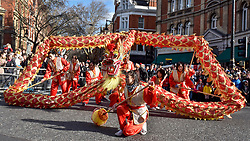 © Licensed to London News Pictures. 18/02/2018. LONDON, UK.  Chinese New Year celebrations take place in Chinatown to welcome the Year of the Dog with a parade featuring dragon and lion dancers and traditional costumed characters.  Chinese New Year in the capital draws hundreds of thousands of Londoners and tourists to enjoy the festivities and is the biggest such celebration outside Asia.  Photo credit: Stephen Chung/LNP