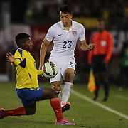 Bobby Shou Wood, (right), USA, is challenged by Jonathan González, Ecuador, during the USA Vs Ecuador International match at Rentschler Field, Hartford, Connecticut. USA. 10th October 2014. Photo Tim Clayton