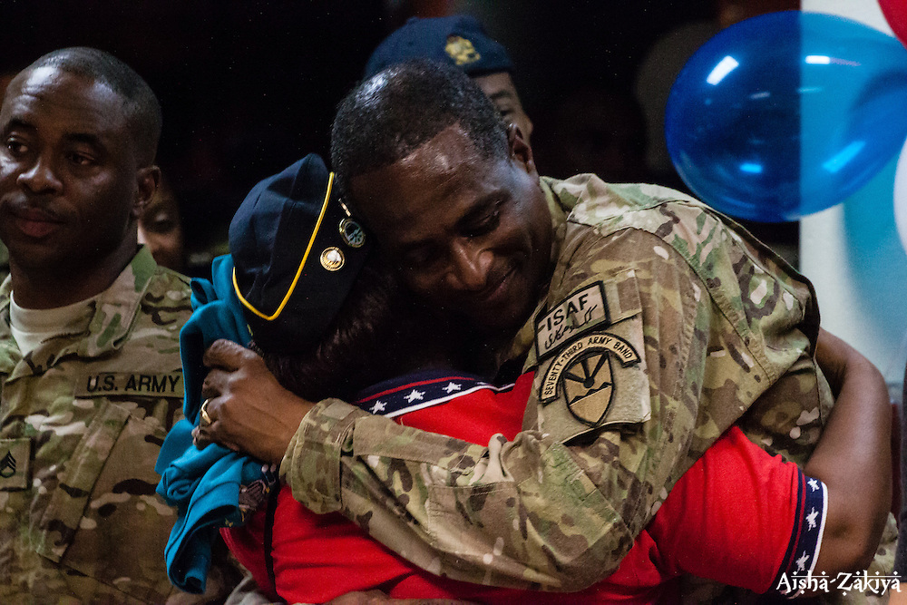 SSG Rae Rouse receives a welcome home hug.  Welcome home ceremony for the St. Thomas based soldiers of the 104th Troop.Command Rapid Aerostat Initial Deployment (RAID) Teamat the Cyril E. King.Airport.  VING's 104th RAID unit deployed to Afghanistan in support of Operation New Dawn. 2 September 2012.  © Aisha-Zakiya Boyd