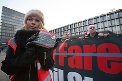 © licensed to London News Pictures. London, UK 11/12/2012. Rail union members demonstrate Outside Euston Railway Station in London over escalating fare rises. There were protests at Euston, King's Cross, Paddington and Eltham, as research was released showing that average rail fares have risen nearly three times faster than wages since the recession began. Photo credit: Tolga Akmen/LNP