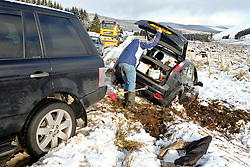 Pictured: <br /> Travellers on the A1701 were willing to lend a hand to help tow a car out of a ditch despite the frozen roads.  Bob Watson was travelling in his Ford Focus from Edinburgh to Moffat when his back wheel dropped into a small pothole, abouit nince miles from the town, which spun his car 180 degrees and into a ditch. His best towing rope was at home and his back up straps were not up to the job when he was getting a tow from Range Rover.  Another set of travellers stoped as they had a tow bar but due to the angle of the car and the ice, the Fopcus only managed to be pulled out about a foot before it bottomed out.  Luckliy a snow plough/gritter stopped and gritted the road to provide purchase for a tow truck with an electric winch to extracate the Focus from the ditch.  Many hands make a difference.<br /> <br /> <br /> Ger Harley | EEm 11 February 2018