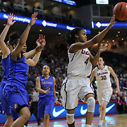 Moriah Jefferson, UConn, passes the ball out while defended by Brittany Hrynko, DePaul, during the UConn Vs DePaul, NCAA Women's College basketball game at Webster Bank Arena, Bridgeport, Connecticut, USA. 19th December 2014