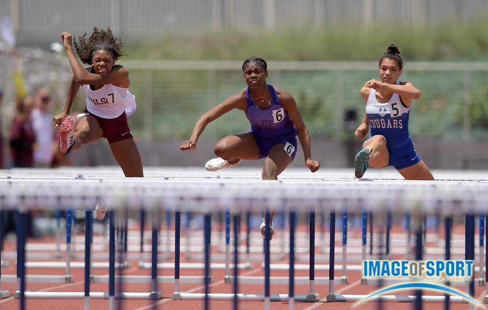 Asjah Atkinson of St. Anthony (center) wins the girls 100m hurdles in 14.08 during the 2019 CIF Southern Section Masters Meet in Torrance, Calif., Saturday, May 18, 2019. From left: Rachel Glen (Long Beach Wilson), Atkinson and Taylor Shorter (Norco).