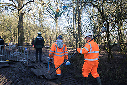 Harefield, UK. 20 January, 2020. Contractors and enforcement agents acting on behalf of HS2 enter the Colne Valley wildlife protection camp which was reoccupied by activists from Extinction Rebellion, Stop HS2 and Save the Colne Valley two days previously. Some of the activists, who are seeking to protect ancient woodland threatened by the high-speed rail link, had been evicted from the camp over the course of the previous two weeks.