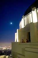 Two Male Tourists Enjoying Scenic City View from the Griffith Observatory Rooftop, Los Angeles, California