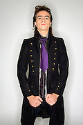 Young male Caucasian in his early 20s in Gothic style clothes studio shot. MR