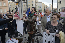 July 3, 2018 - Warsaw, Poland - Several thousand people gathered in front of the Sad Najwyzszy, the Polish Supreme Court in Warsaw, Poland on July 3, 2018 to protest the ousting of nearly 40 percent of its judges. A recently passed law which critics say is meant to remove political opposition forced nearly half of Supreme Court judges to retire early. (Credit Image: © Jaap Arriens/NurPhoto via ZUMA Press)