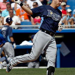 March 16, 2012; Dunedin, FL, USA; Tampa Bay Rays third baseman Evan Longoria (3) reacts after hitting a fly out during the top of the sixth inning of a spring training game against the Toronto Blue Jays at Florida Auto Exchange Stadium. Longoria was among 71 members of the organization including players and club personnel that shaved their heads for the charity Cut for a Cure event to raise money and awareness for the Pediatric Cancer Foundation. Mandatory Credit: Derick E. Hingle-US PRESSWIRE
