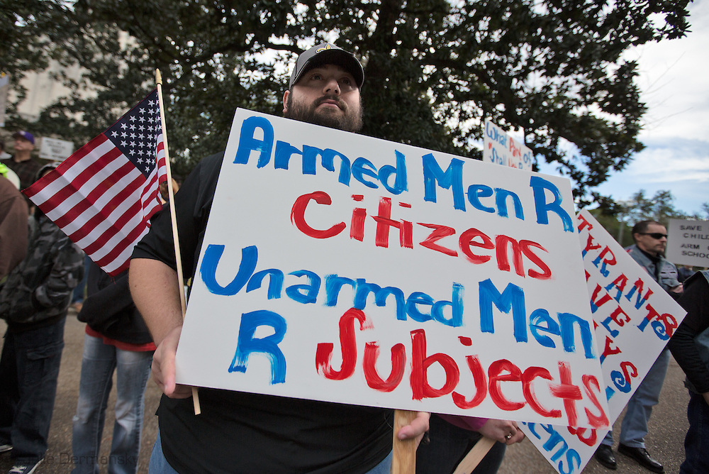 "January 18, Baton Rouge,<br /> Matthew Streeter,at a pro-gun rally organized by ""Guns across America"" on ""Gun Appreciation Day"" says, <br /> ""People have not outgrown the capacity for evil<br /> so the need for the 2nd amendment is now and vital as it ever was.""<br />  After the massacre at  a school in Sandy Hook, Connecticut , the debate over gun control in America became a key political issue."