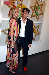 MATTHEW MELLON and NOELLE RENO at an exhibition of photographs by Matthew Mellon entitled Famous Feet - featuring well known people wearing shoes from Harrys of London, held at Hamiltons Gallery, Carlos Place, London on 22nd November 2004.<br /><br />NON EXCLUSIVE - WORLD RIGHTS