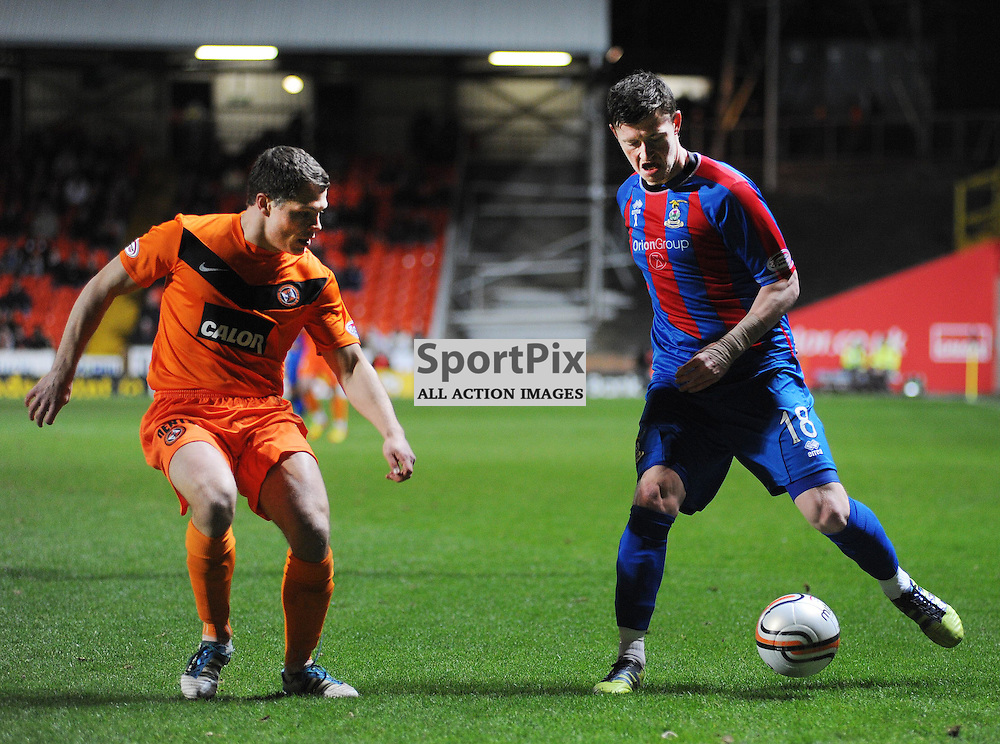 Dundee Utd v Inverness C.T. Clydesdale Bank Premier League..Shane Sutherland (18) under presure from Sean Dillon