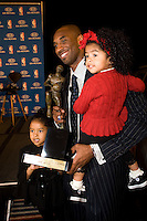 06 May 2008: Guard Kobe Bryant of the Los Angeles Lakers poses with his daughters Natalia, l, and Gianna after winning the 2008 Most Valuable Player award in Los Angeles, CA.
