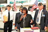 Freeport, New York, USA. September 10, 2014. Town of Hempstead Councilwoman DOROTHY GOOSBY speaks at a dockside remembrance ceremony in honor of victims of the terrorist attacks of September 11 2001, at the boat Miss Freeport V, on Freeport's Nautical Mile. Further ceremonies were held on board the vessel, which sailed from the Woodcleft Canal on the South Shore of Long Island, on the eve of the 13th Anniversary of the 9/11 attacks.