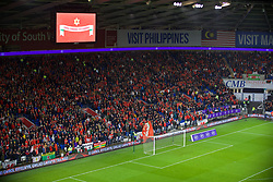CARDIFF, WALES - Sunday, October 13, 2019: Wales supporters sing the national anthem before the UEFA Euro 2020 Qualifying Group E match between Wales and Croatia at the Cardiff City Stadium. (Pic by Paul Greenwood/Propaganda)