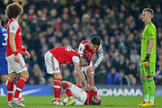 CORRECTION Arsenal defender Shkodran Mustafi (20) on the ground following a challenge during the Premier League match between Chelsea and Arsenal at Stamford Bridge, London, England on 21 January 2020.