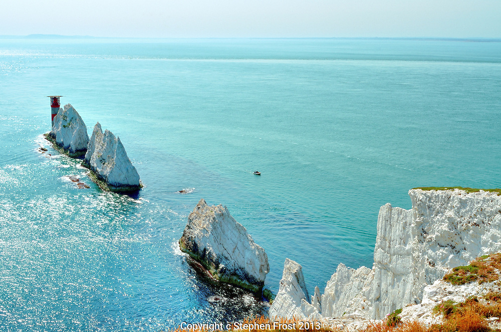 The Needles, a row of three stacks of chalk that rise out of the sea off the western shore of the Isle of Wight, England.