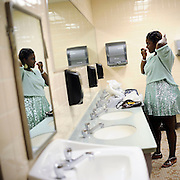 Nekita Waller prepares to sing in Newport, Rhode Island using the casino bathroom as a dressing room.