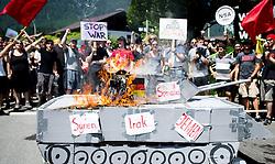 05.06.2015, Garmisch Partenkirchen, GER, G7 Gipfeltreffen auf Schloss Elmau, Circa 300 Menschen demonstrieren in Garmisch-Patenkirchen gegen den G7-Gipfel im benachbarten Elmau, im Bild Demonstranten verbrennen einen Panzer aus Pappe // during Protest of the G7 opponents prior to the scheduled G7 summit which will be held from 7th to 8th June 2015 in Schloss Elmau near Garmisch Partenkirchen. Garmisch Partenkirchen, Germany on 2015/06/05. EXPA Pictures © 2015, PhotoCredit: EXPA/ Eibner-Pressefoto/ Gehrling<br /> <br /> *****ATTENTION - OUT of GER*****