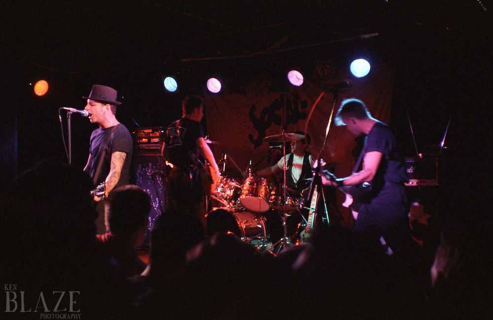 The band Social Distortion performs at Peabody's on May 8, 1990 in cleveland, Ohio. Social Distortion is a California based punk band.