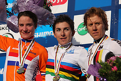Marianne Vos (Nederland) , winner Giorgia Bronzini (Italy)  and  . Ina Teutenberg (Germany)  )  at medal ceremony after the Women´s Elite Road Race on day five of the UCI Road World Championships on September 24, 2011 in Copenhagen, Denmark. (Photo by Marjan Kelner / Sportida Photo Agency)