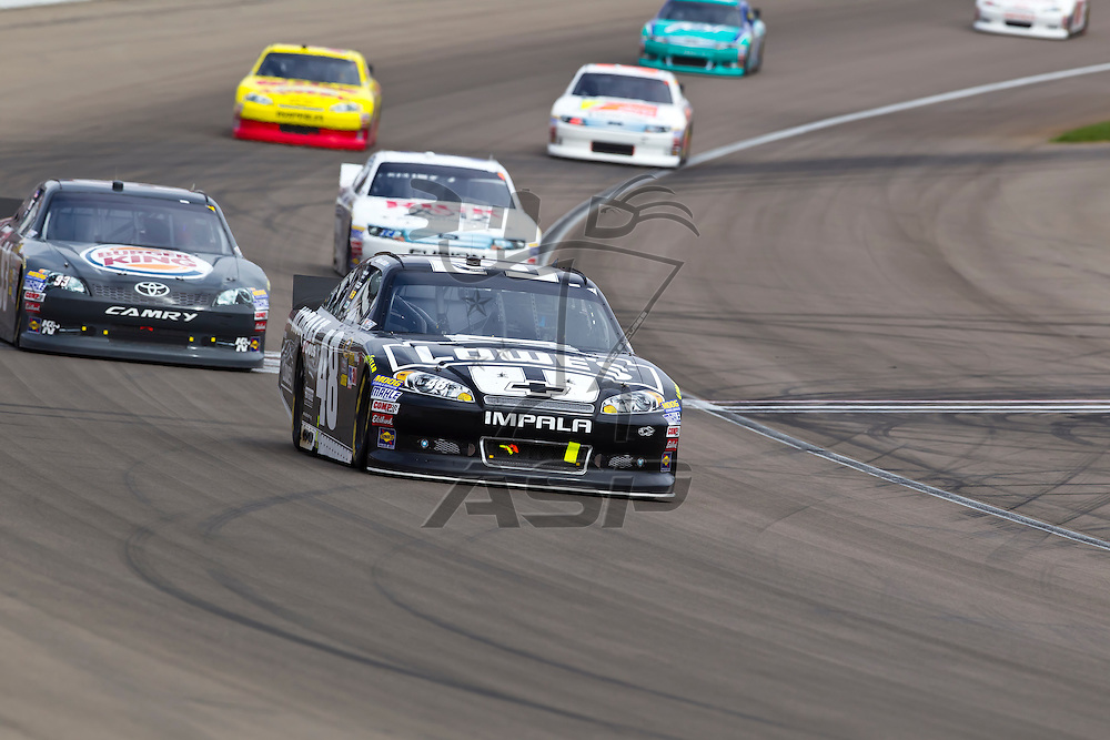 LAS VEGAS, NV - MAR 11, 2012:  Jimmie Johnson (48), Travis Kavapil (93), and David Ragan (34) battle for position during the Kobalt Tools 400 race at the Las Vegas Motor Speedway in Las Vegas, NV.