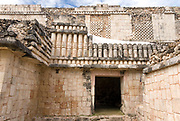Mexico – Jan 19 2007: Doorway in The Quadrangle of the Birds West Building, Maya Ruins in the Puuc architectural style at Uxmal