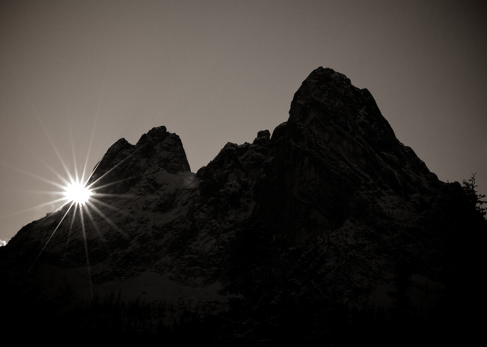 Liberty Bell Mountain under starburst sunshine