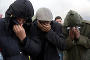 Manifestants anonymes au cimetiere Jallez, qui souffretent du gaz lacrymogene tire par la police. l'hommage du peuple Tunisien a Chokri Belaid fut perturbe par incidents entre jeunes casseurs et la police anti-emeutes. Des voitures sont brulees.