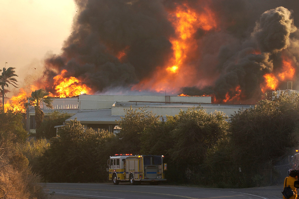The Shekell Fire burns the MGR Design building, formerly Egg City, at the intersection of Grimes Canyon Road and Shekell Road in Moorpark on Sunday evening.