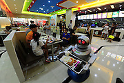 KUNSHAN, CHINA - AUGUST 08: (CHINA OUT) <br /> <br /> Robot Restaurant <br /> <br /> Robot waiters are seen at a robot restaurant on August 8, 2014 in Kunshan, Jiangsu Province of China. The robots can speak 40 simple Chinese sentences. Each robot can service five to eight years, with the cost of 40,000 - 50,000 yuan (6,480 - 8,100 USD). And each robot only need three kwh of electricity for the whole day\'s operation, from 9 a.m. to 8 p.m<br /> ©Exclusivepix